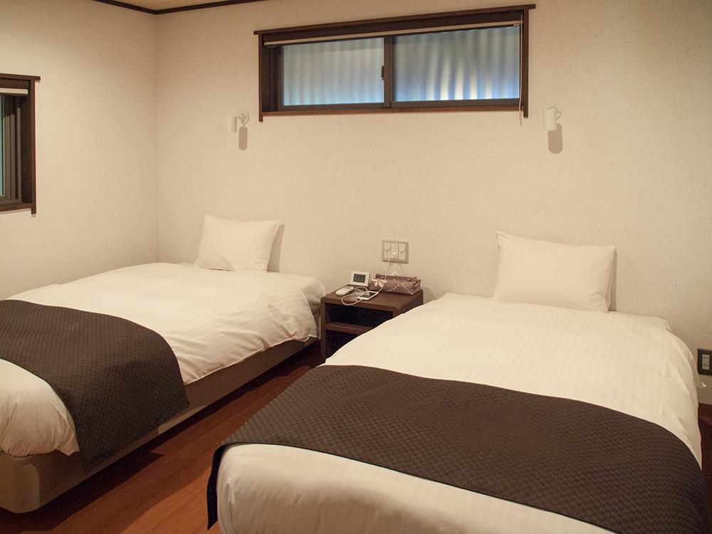 尚文の離れ 露天風呂付き客室のベッド